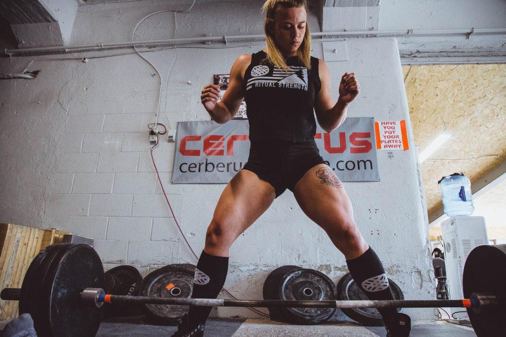Gem Freaks female strength training with home gym equipment as her fitness goals